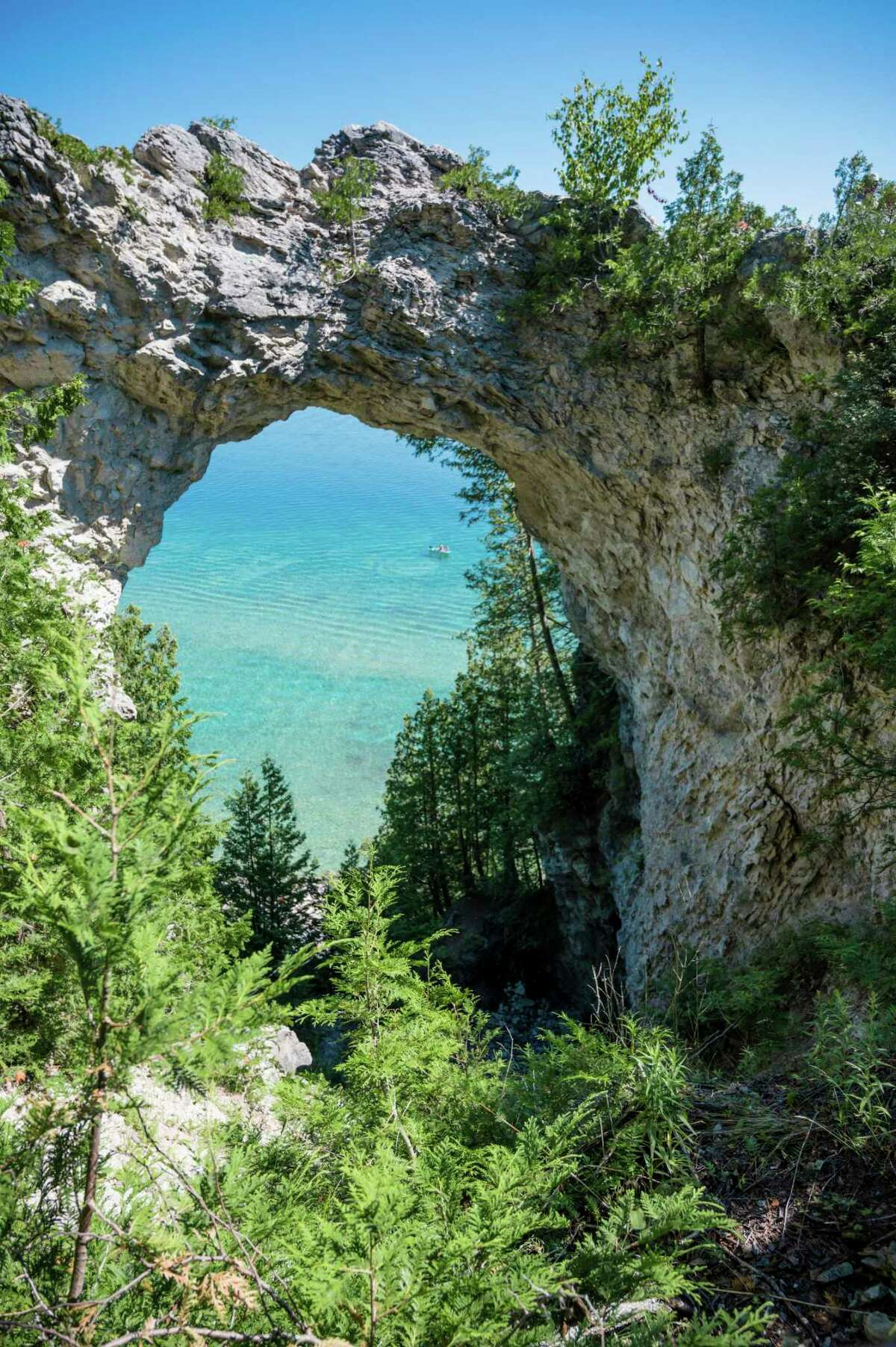 Aman's body was found at the base of Arch Rock by a passerby on Mackinac Island, and authorities say he likely fell from the top of the unique natural limestone arch. (Courtesy Photo/Getty Images)