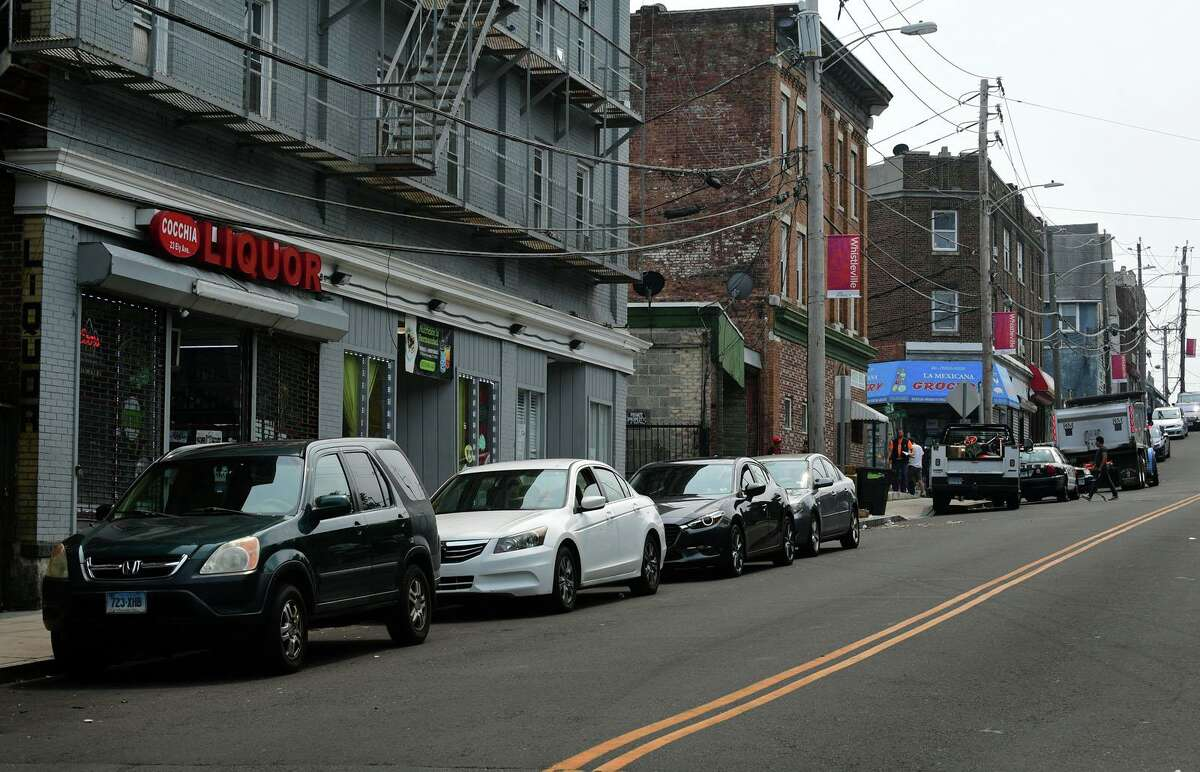 Cars parked along Ely Ave Tuesday, July 20, 2021, in Norwalk, Conn. The Norwalk Traffic Authority is introducing timed parking along Ely Avenue between Mulvoy Street and Lowe Street to reduce the number of parked vehicles in the area.