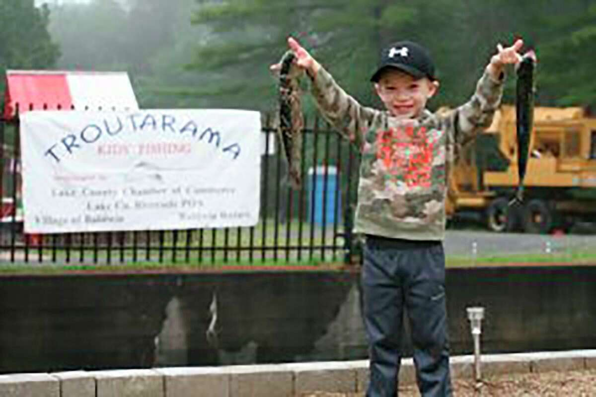 """Kids ages 5-10will betrying to """"catch the big one""""at the Baldwin Rotary Fishing Derby this weekend. The annual Troutarama festival ends Saturday. (Pioneer file photo)"""