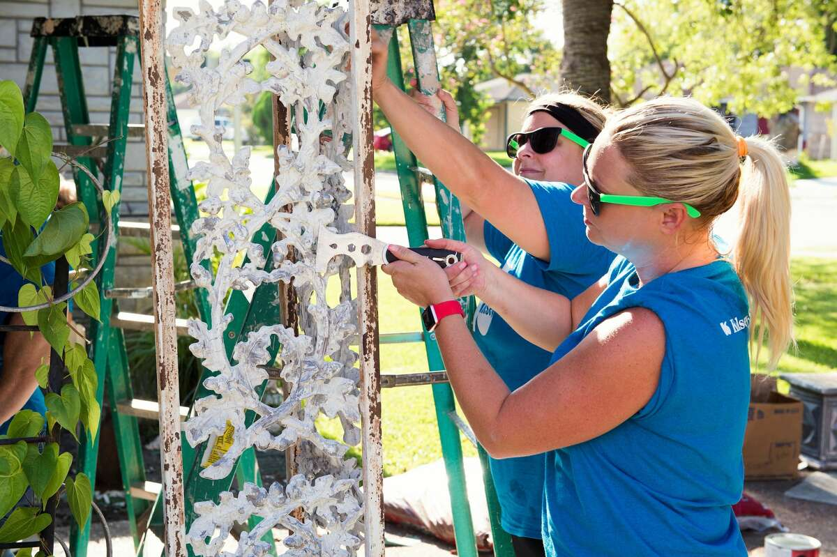 An old coat of paint gets scraped away during a Team Up to Clean Up event.