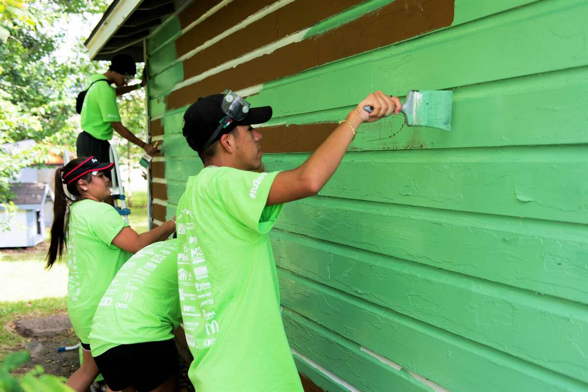 Team Up to Clean Up volunteers put a lively coat of paint on a house during a previous event. This year's edition will be Oct. 16.