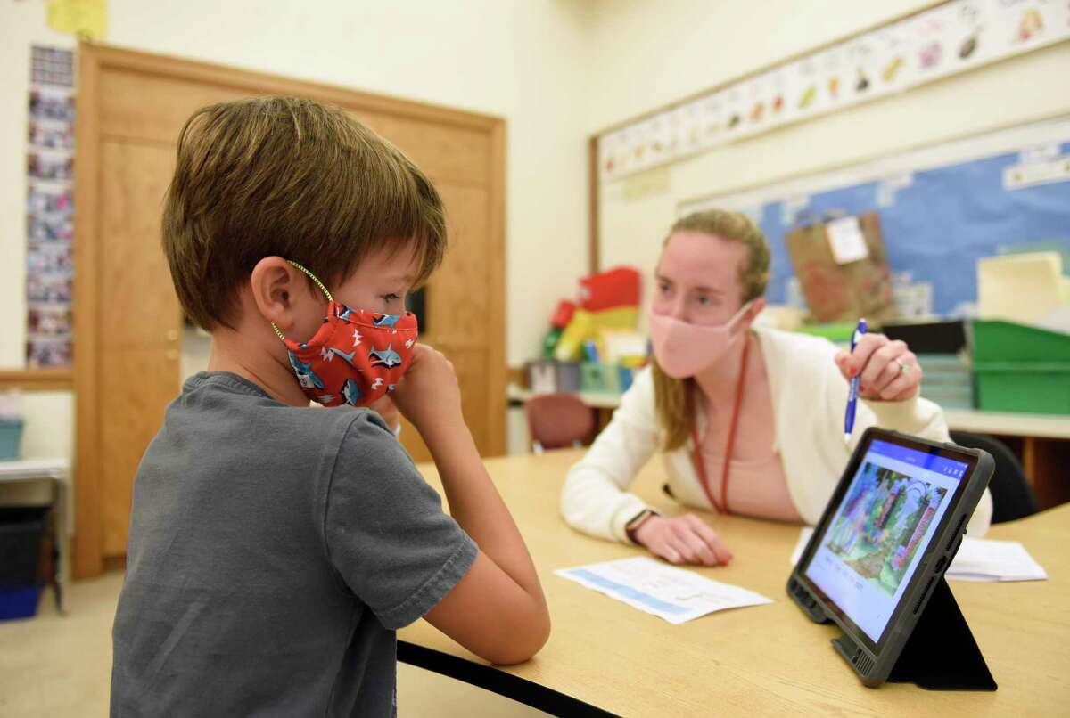 Teacher Heather Semmes works with rising first-grader Christian Honey during the summer academy at Julian Curtiss School in Greenwich, Conn. Tuesday, July 20, 2021. About 50 kindergarten through fifth-graders are attending the summer enrichment camp, which runs every morning from 8:30 to 11:30 a.m.