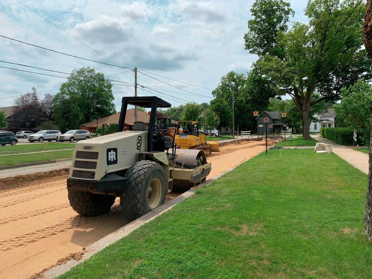 Construction has begun on an initial section of Locust street in downtown Big Rapids to repair damaged pavement, the firstsection is expected to take around three weeks to complete before the crew starts work on the next segment of road. (Pioneer photo/Olivia Fellows)