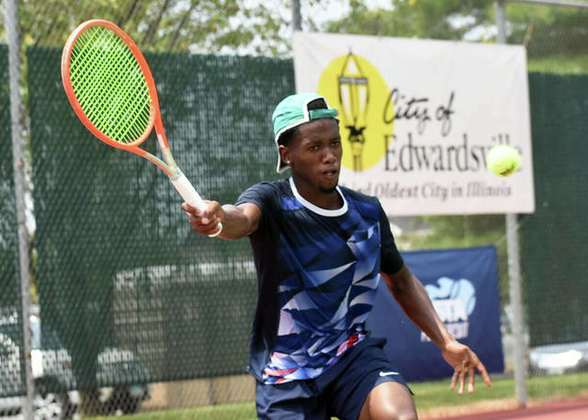 Siphos Montsi reaches for a shot during his second-round match against Paul Jubb on Court 2 inside the EHS Tennis Center on Thursday in Edwardsville.