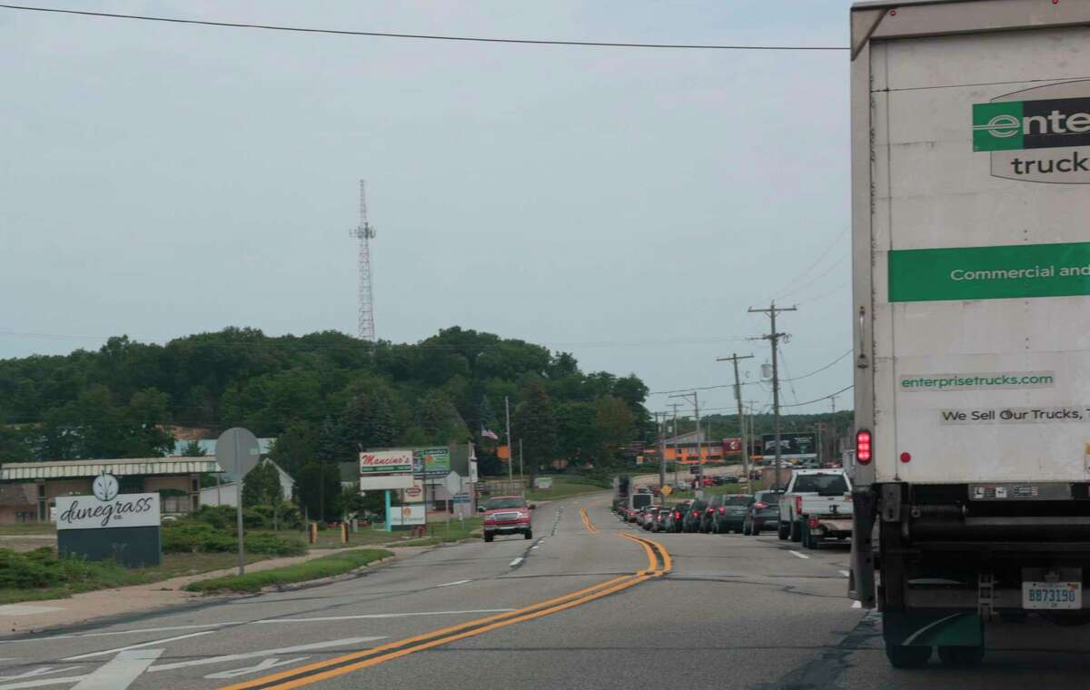 Traffic was backed up to the south of M-55 near Monroe Street in Manistee before noon on Thursday. (Jeff Zide/News Advocate)