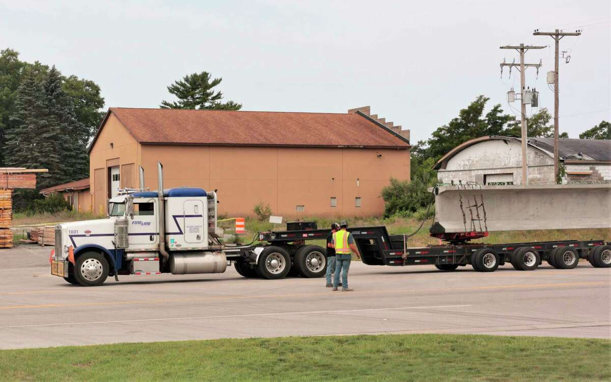 A truck hauls a center-span beam to the U.S. 31/M-55 construction site in Manistee on Thursday. (Jeff Zide/News Advocate)
