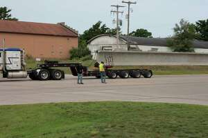 A truck delivers one of two center-span beams for bridge work at the U.S. 31/M-55 intersection in Manistee on Thursday. (Jeff Zide/News Advocate)