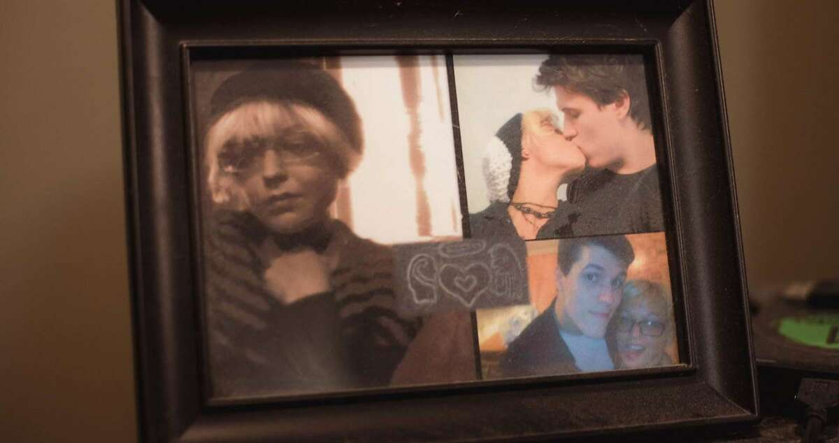 Photos of Joshua Barbeau and Jessica Pereira in a frame in Barbeau's home.