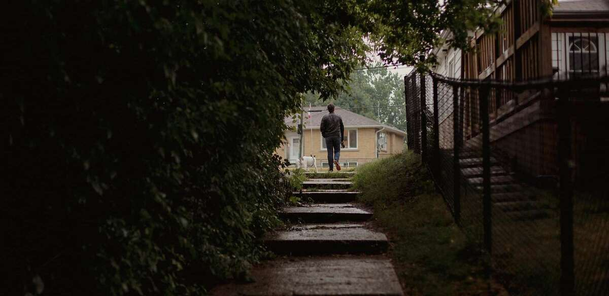 Joshua Barbeau walks his rescue dog, Chauncey, near his home.