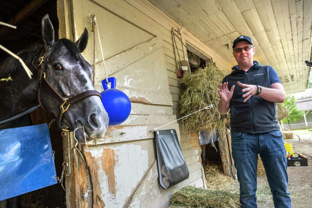 Trainer Rob Atras spends some time with his CCA Oaks entrant Maracuja in his barn at the Saratoga Race Course Thursday July 22, 2021 in Saratoga Springs, N.Y. Photo Special to the Times Union by Skip Dickstein