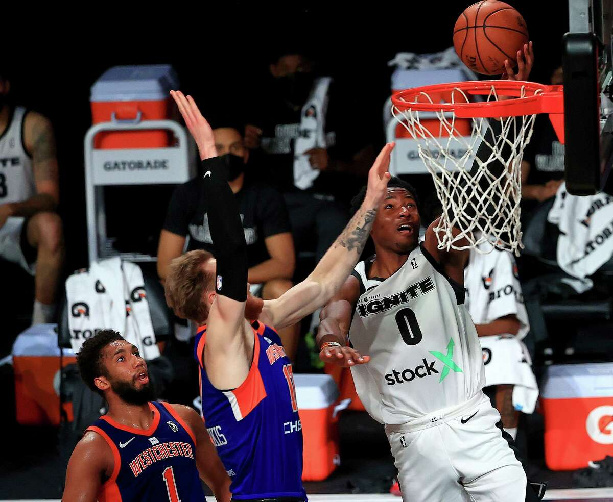 Jonathan Kuminga (0) of the G League Ignite drives to the basket against the Westchester Knicks in Florida in February.