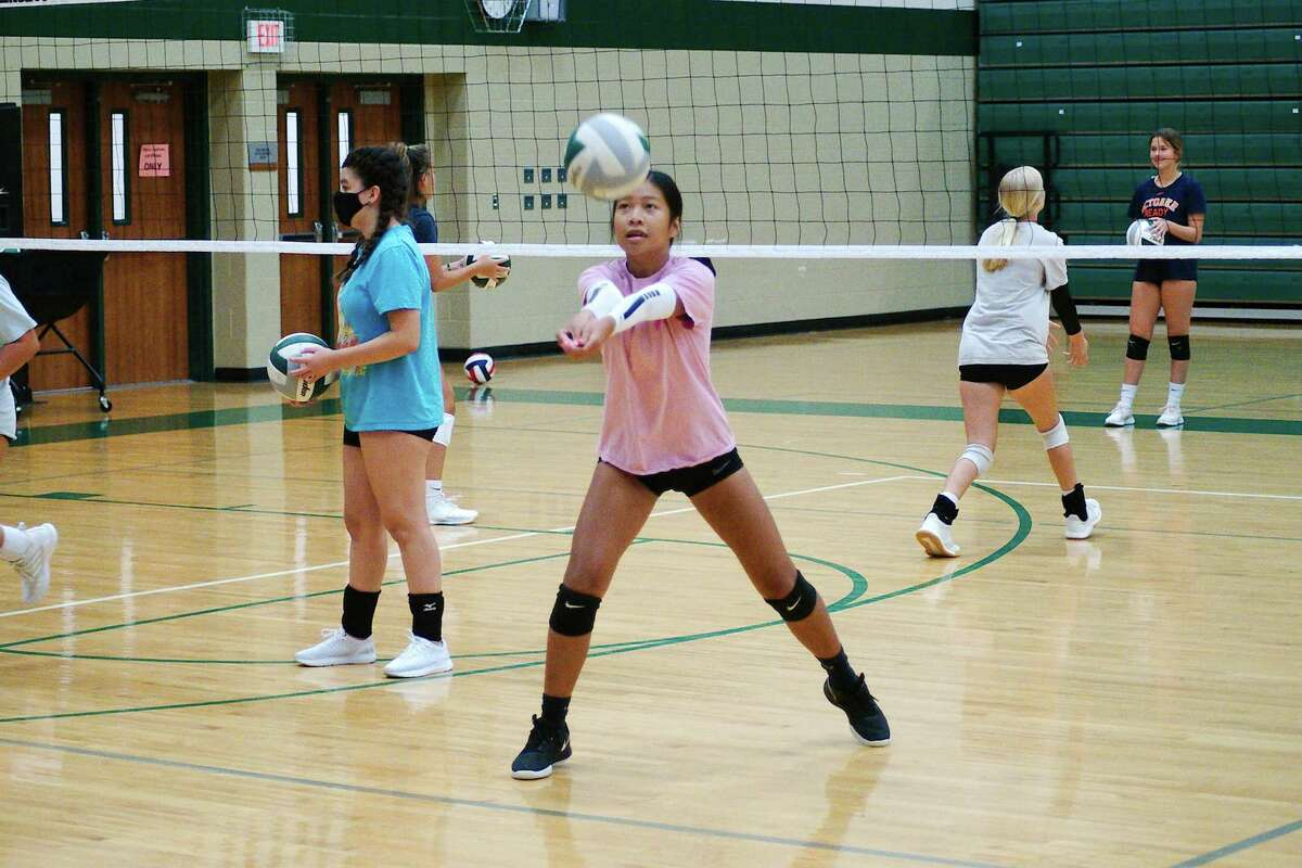 Tina Vo participates in a hitting drill at at volleyball camp at Clear Falls High School.