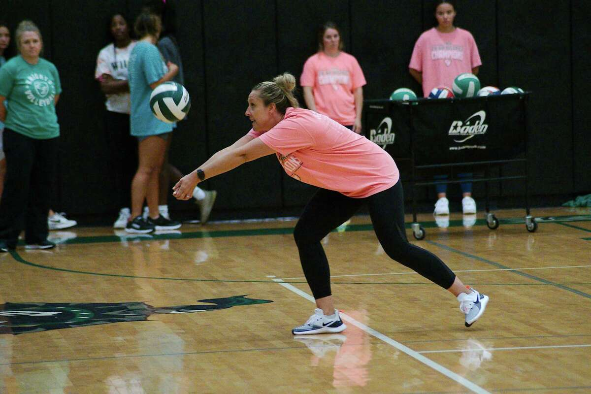 Clear Falls volleyball coach Alison Williams demonstrates a technique.