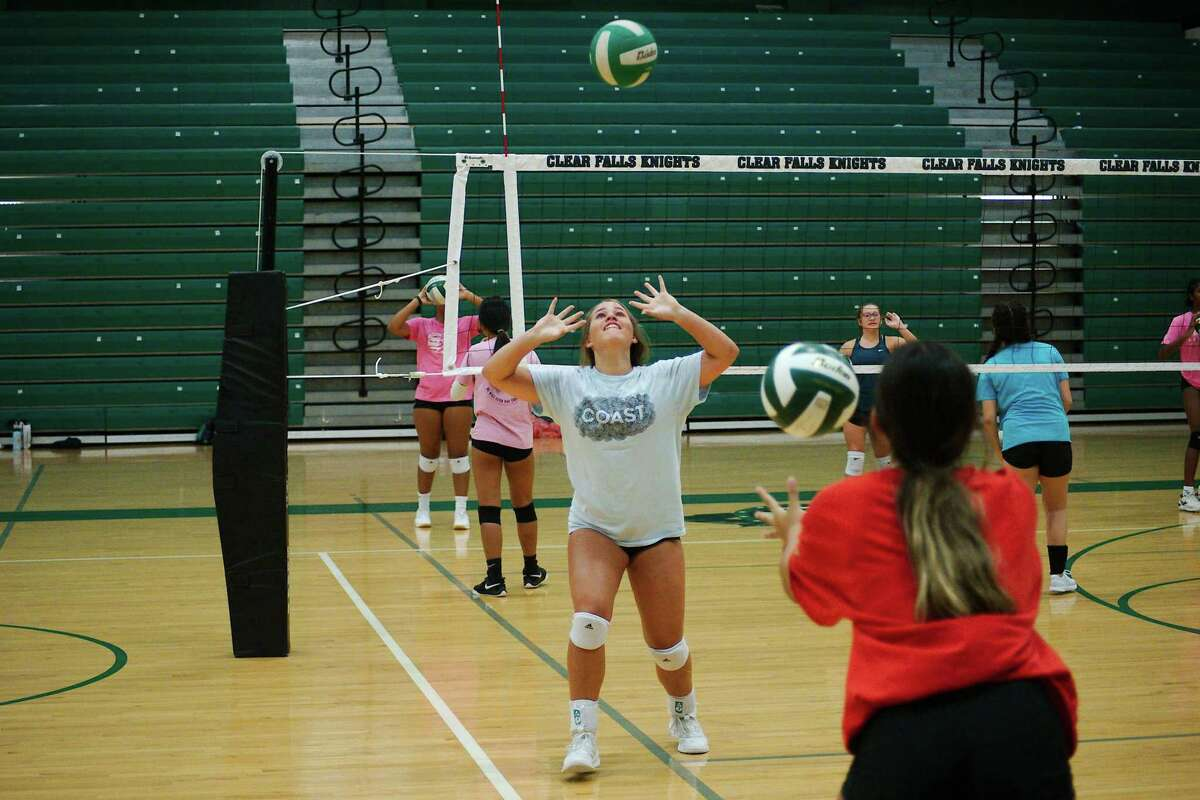 Tessa Burnett and Addison Smith work to keep two balls moving the same time.