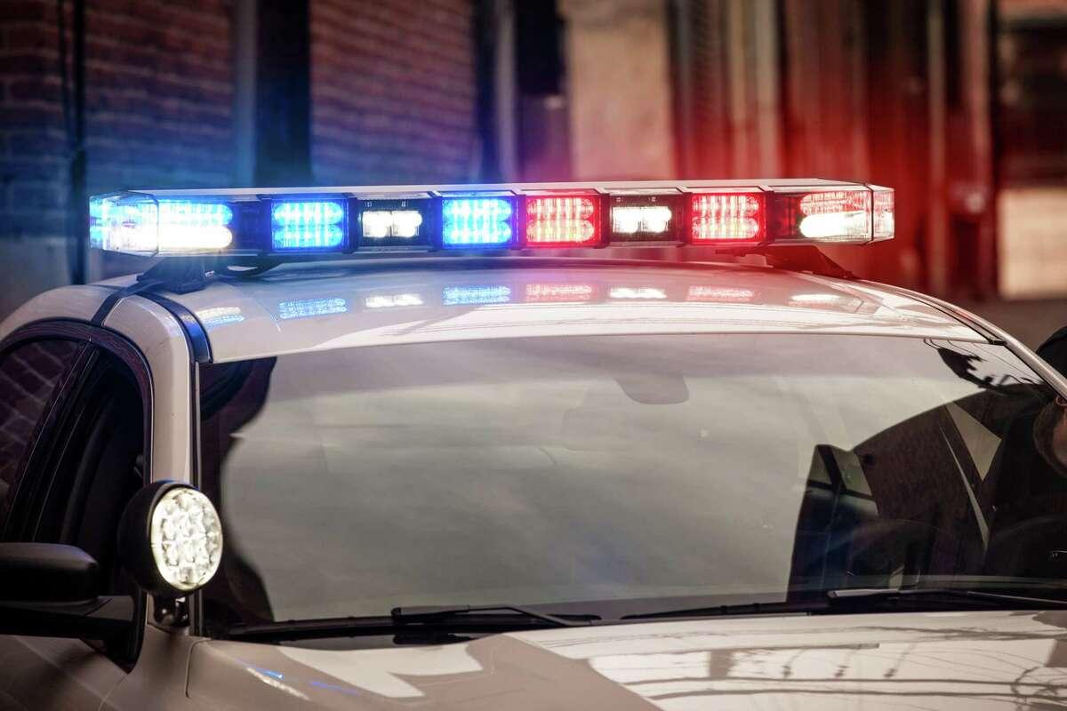 Modern LED light bar on police cruiser flashing red and blue emergency lights.