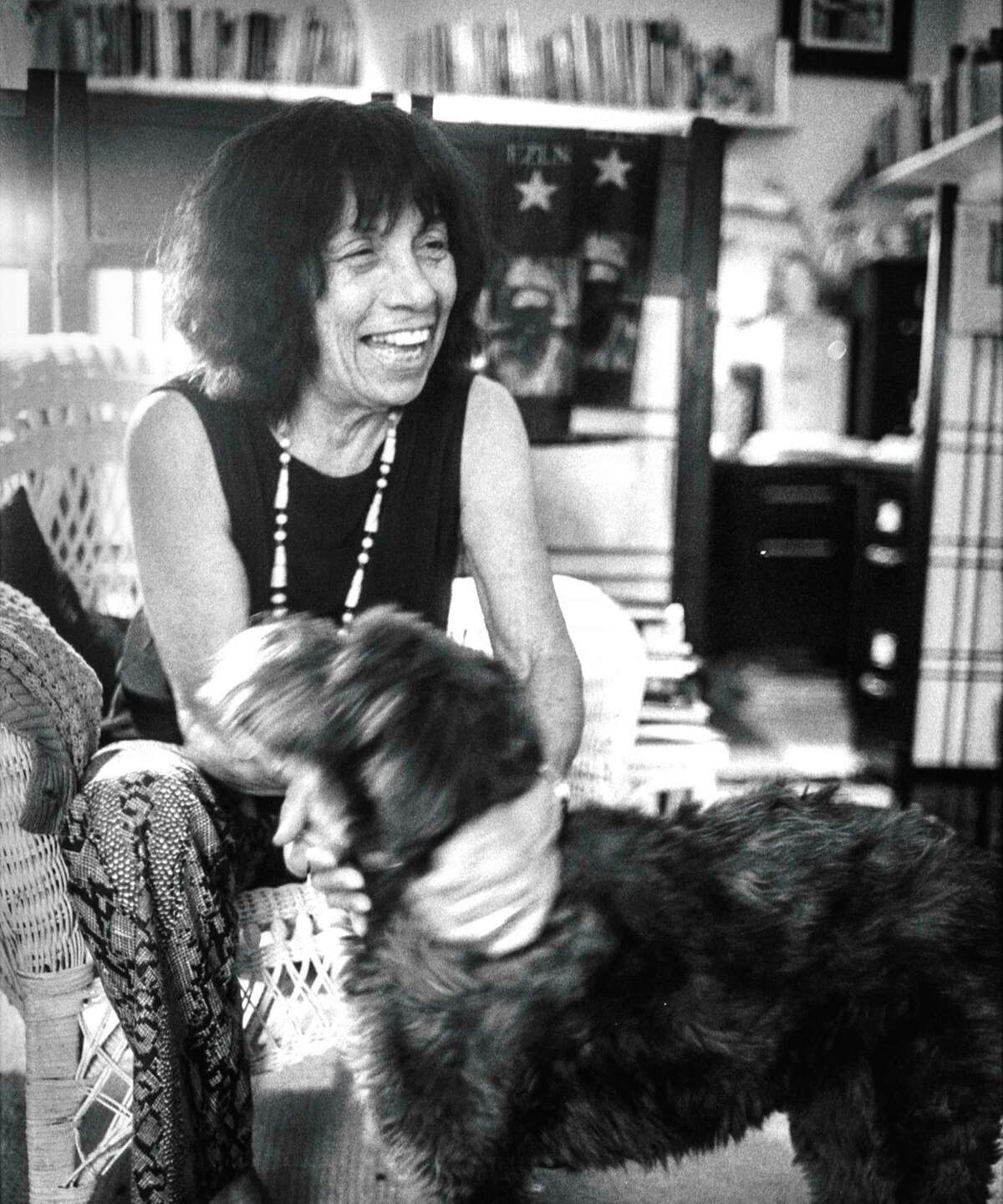 """Elizabeth """"Betita"""" Martínez, shown with Xochi, wrote prolifically in her Mission District home."""