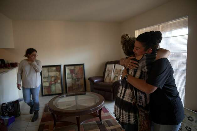 Nancy Aguirre hugs Valerie Salas who helped her daughter Brittany when she was living on the streets. Her daughter is now sober and building a life for herself starting with a new apartment. Photo: Jessica Phelps/San Antonio Express-News / **MANDATORY CREDIT FOR PHOTOG AND SAN ANTONIO EXPRESS-NEWS/NO SALES/MAGS OUT/TV  © 2021 San Antonio Express-News
