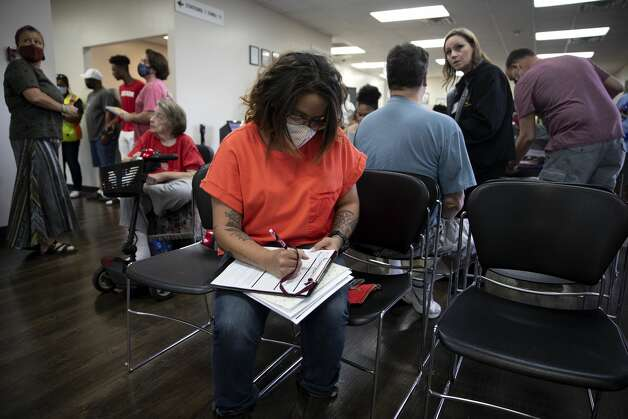 One of the last things Brittany Aguirre had to do to get her life on track after getting clean from drugs and alcohol was obtaining her driver's license. Photo: Jessica Phelps/San Antonio Express-News / **MANDATORY CREDIT FOR PHOTOG AND SAN ANTONIO EXPRESS-NEWS/NO SALES/MAGS OUT/TV  © 2021 San Antonio Express-News