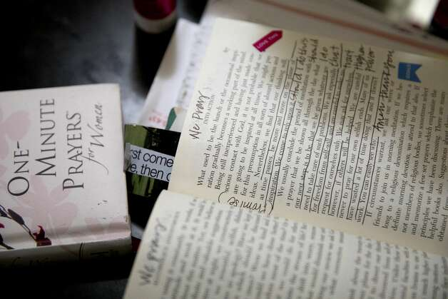 Every morning and most evenings Brittany Aguirre will read though her prayer books and bible and write in her journal. Photo: Jessica Phelps/San Antonio Express-News / **MANDATORY CREDIT FOR PHOTOG AND SAN ANTONIO EXPRESS-NEWS/NO SALES/MAGS OUT/TV  © 2021 San Antonio Express-News