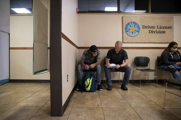 Officer Morgan Lucas helps Terrell fill out his paperwork to get his ID. Officer Lucas works with Project Hope, a branch of the SAPD Bike Patrol that helps unsheltered men and women get their IDs so they can get jobs and permanent housing. Photo: Jessica Phelps/San Antonio Express-News / **MANDATORY CREDIT FOR PHOTOG AND SAN ANTONIO EXPRESS-NEWS/NO SALES/MAGS OUT/TV  © 2021 San Antonio Express-News
