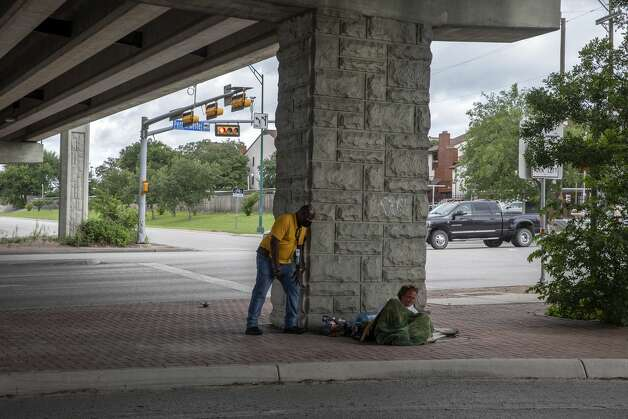 Trevor Baker, a clinical homeless outreach worker with the city's Department of Human Services talks with Josh Palumbo, who has been sleeping under Wurzbach Parkway. Trevor let Josh know he was in an extremely unsafe place and he should move somewhere else for his own safety. Photo: Jessica Phelps/San Antonio Express-News / **MANDATORY CREDIT FOR PHOTOG AND SAN ANTONIO EXPRESS-NEWS/NO SALES/MAGS OUT/TV  © 2021 San Antonio Express-News