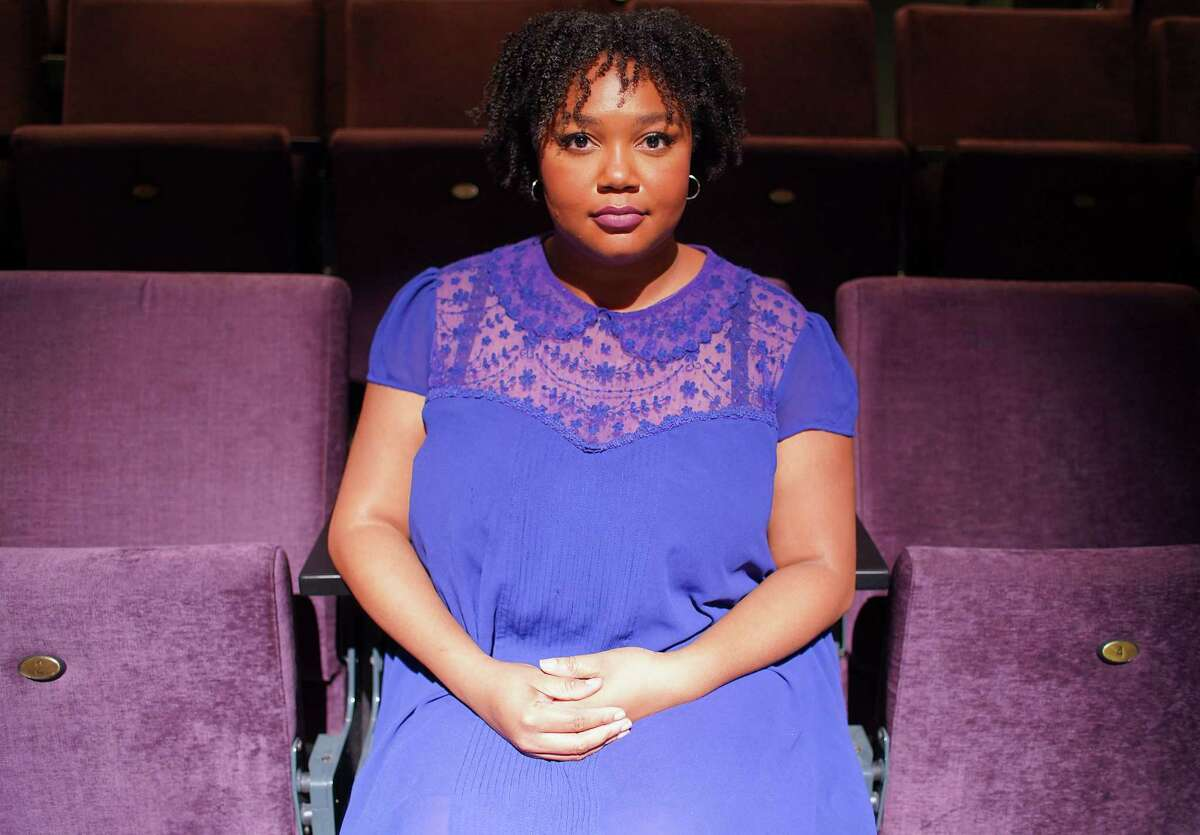 Eboni Bell, inclusion, engagement and training director at Stages, stands one a stage at The Gordy in Houston on Tuesday, July 20, 2021.