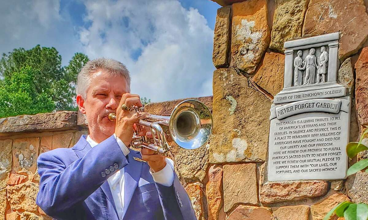 Trumpeter Len Valka closed the Never Forget Garden dedication with a rendition of Taps