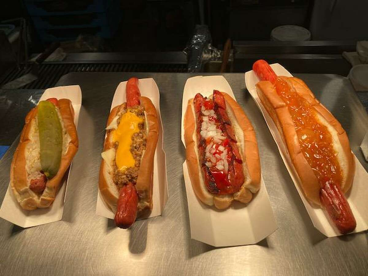 From left, the Famous Hot Dog, the LCD with double cheese, the Red Hot with sweet red pepper relish and onions and the New Yorker 10-inch all beef