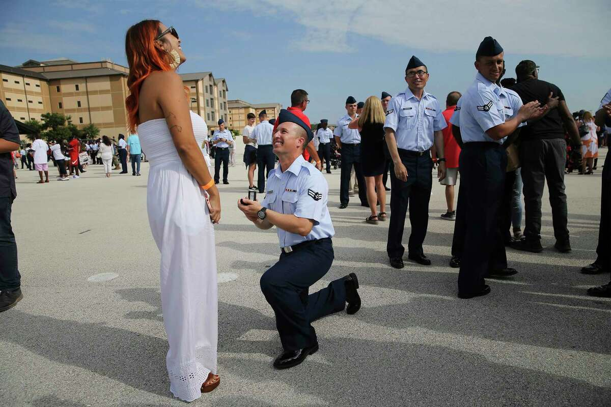 Airman 1st Class Roberto Nazario Rodriguez proposes to Nerialis Vazquez after an Air Force graduation ceremony for basic training recruits at Joint Base San Antonio-Lackland on Thursday, July 22, 2021. It was the first public graduation ceremony at Lackland in 16 months.