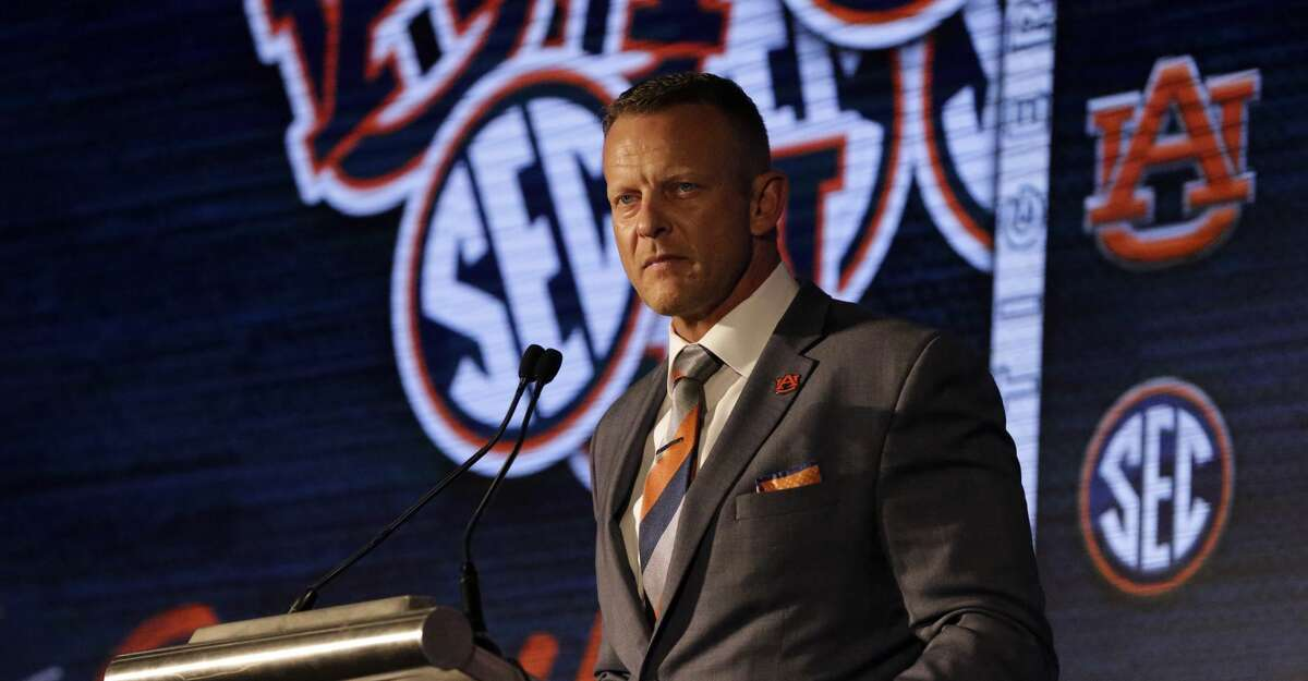 Auburn head coach Bryan Harsin speaks to reporters during the NCAA college football Southeastern Conference Media Days Thursday, July 22, 2021, in Hoover, Ala. (AP Photo/Butch Dill)