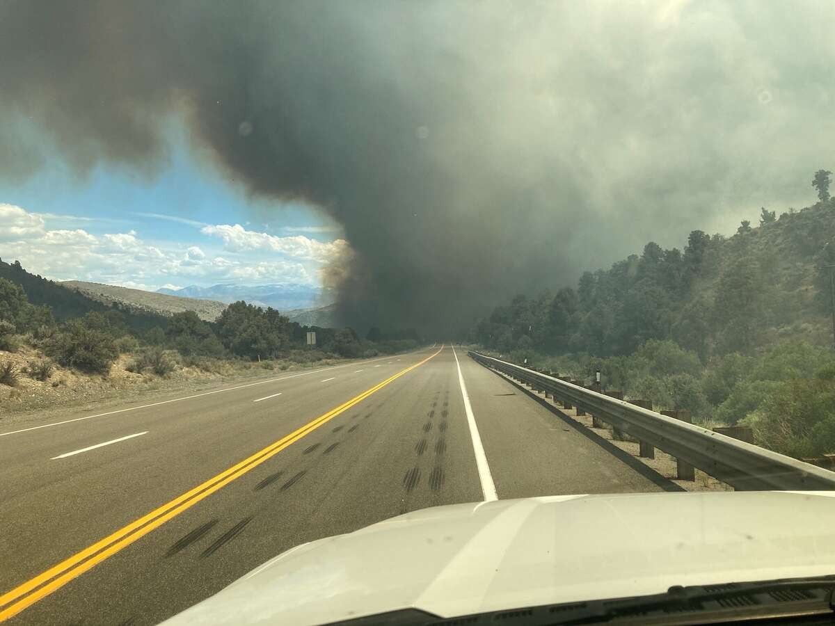 A spot fire from the Tamarack Fire crossed U.S. 395 near Holbrook Junction, Nevada, on July 22, 2021.