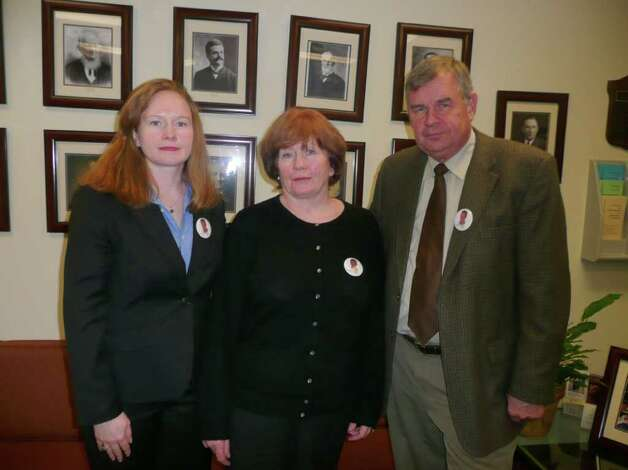 From left, Bree Smith, sister of George Smith IV, and her mother and father, Maureen and George Smith III, hope that a recent settlement will lead to some answers about George's disappearance. The newlywed vanished on his honeymoon cruise back in 2005. Photo: Anne W. Semmes / Greenwich Citizen