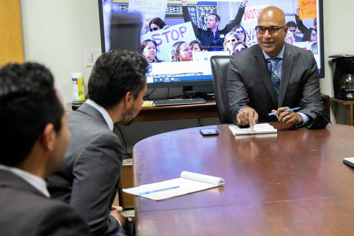 San Francisco Public Defender Manohar Raju attends a morning meeting with colleagues in his office. Raju supports state legislation to create a pilot program called Be the Jury to improve the racial and economic diversity on juries. The concept of paying jurors more would allow more low-income people to serve.