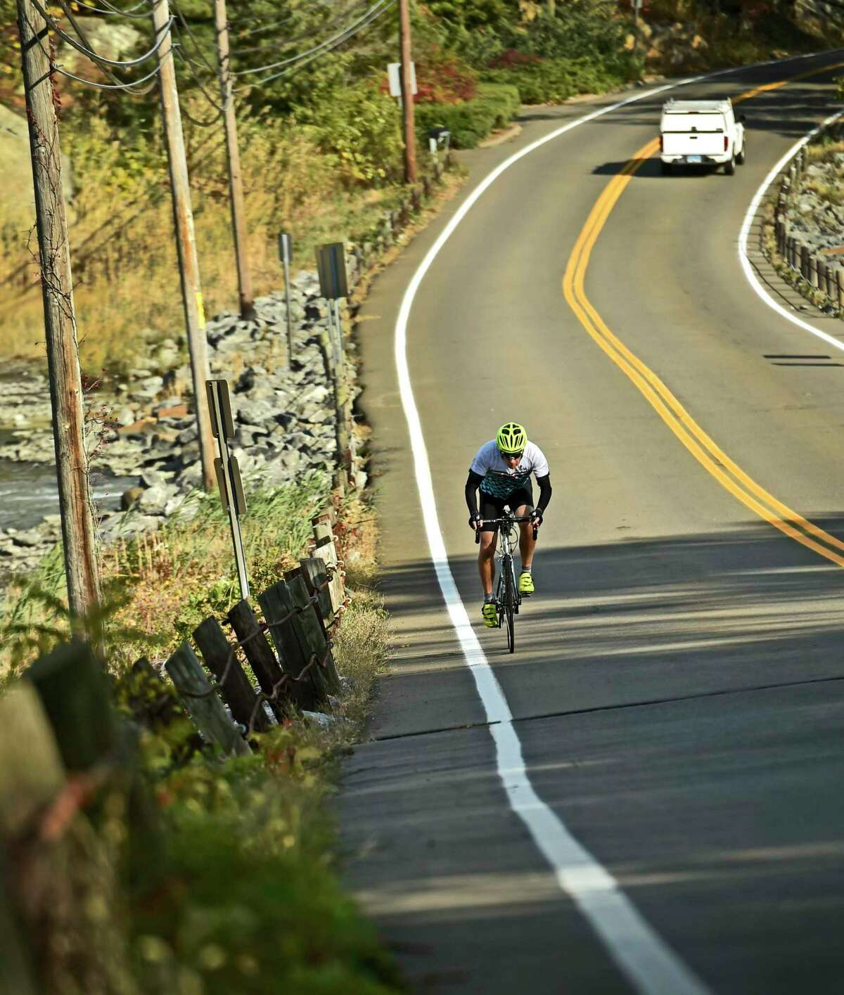 A bicyclist tours Route 146 between Stony Creek in Branford and Guilford.