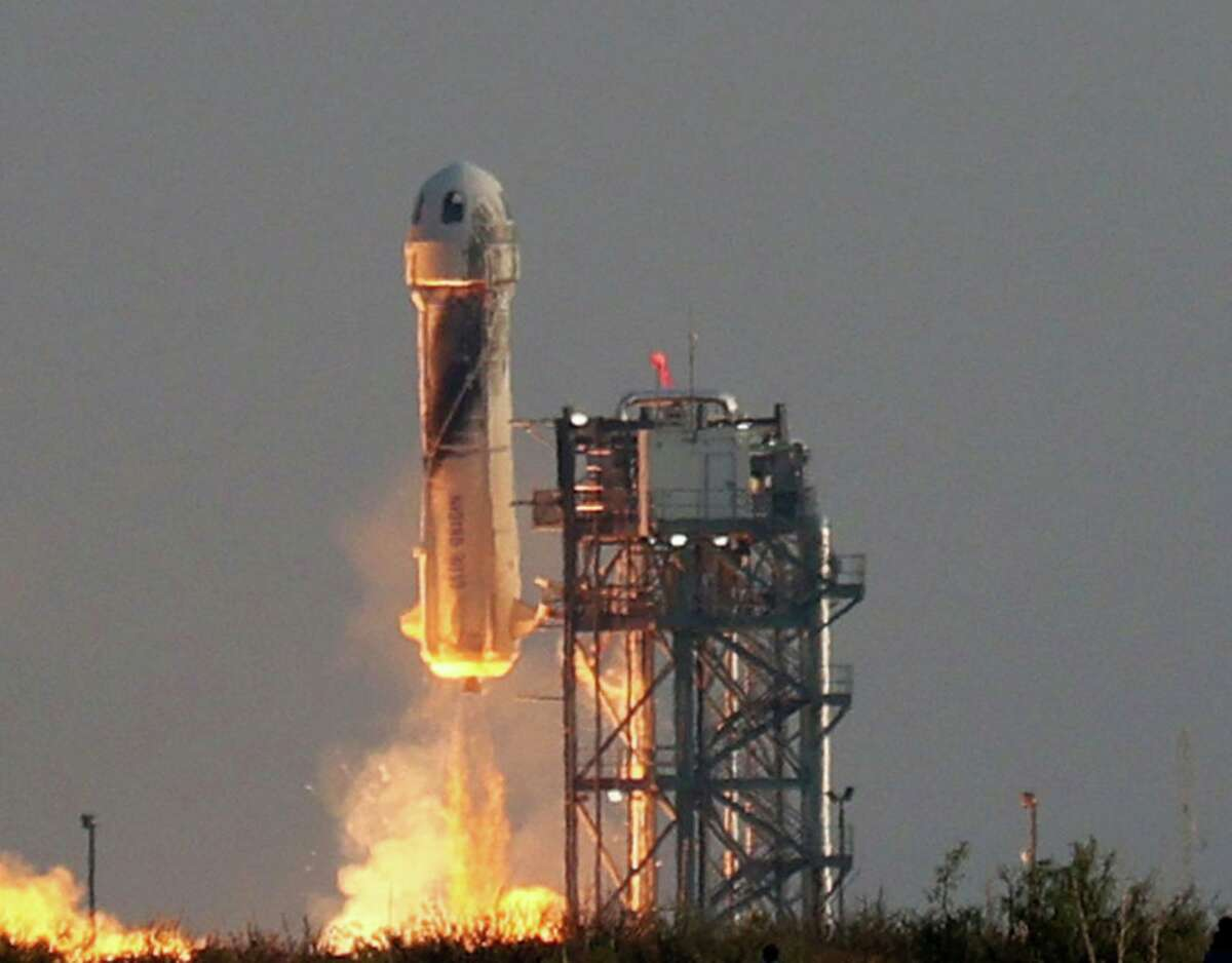 Blue Origin's New Shepard lifts-off from the launch pad carrying Jeff Bezos along with his brother Mark Bezos, 18-year-old Oliver Daemen, and 82-year-old Wally Funk on July 20, 2021 in Van Horn, Texas. Jeff Bezos and the crew are riding in the first human spaceflight for the company.