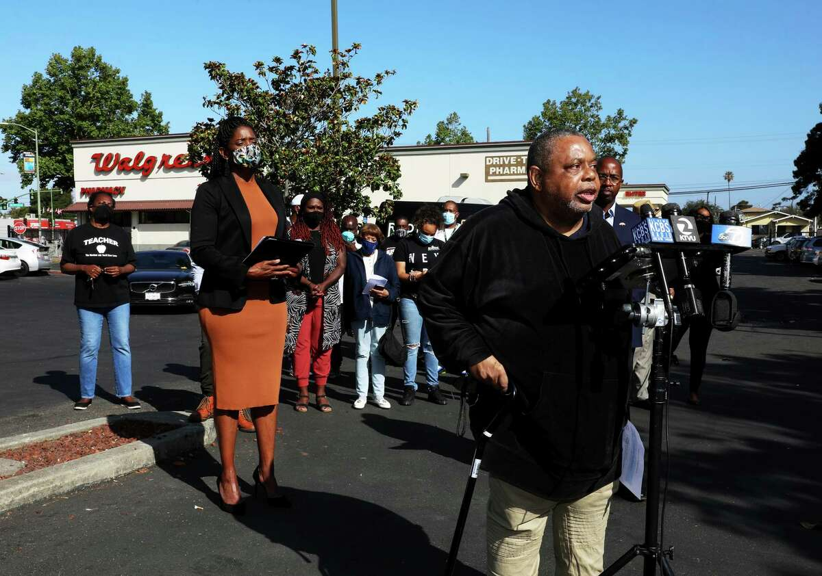 """Willie Stevens, 73, a resident at Allen Temple Arms, speaks during a press conference outside of the Walgreens at 8102 International Blvd. Stevens is hoping Walgreens puts off its plan to close this location by the end of the month. """"Most of the cashiers knew us by name,"""" Stevens said. """"It helps a lot when the cashiers know you."""""""
