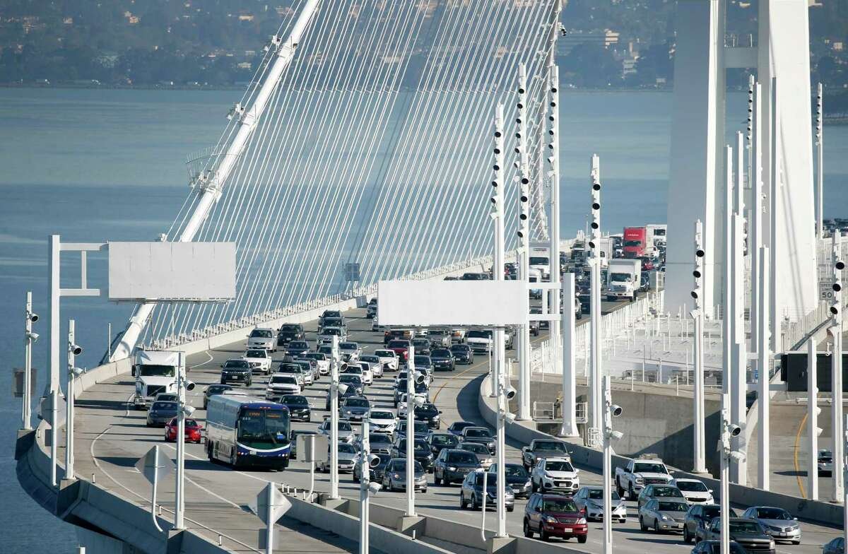 This file photograph shows travelers approaching the Yerba Buena Island tunnel on westbound lanes of the Bay Bridge in San Francisco, Calif. on Friday, Jan. 10, 2020.