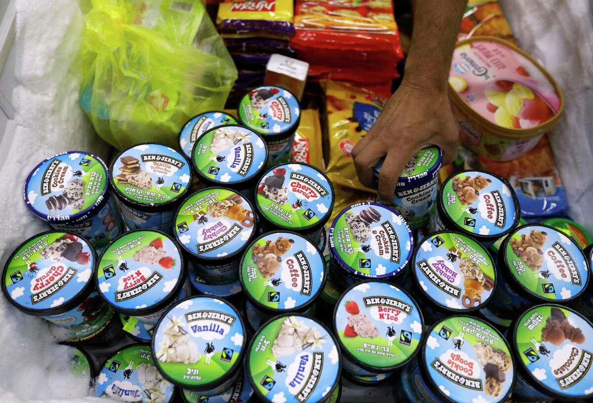 """A man buys Ben & Jerry's ice cream in Jerusalem on July 20, 2021. Ben & Jerry's announced on July 19, 2021 they would stop selling their ice cream in the occupied Palestinian territories, saying its sale """"is inconsistent with our values."""""""