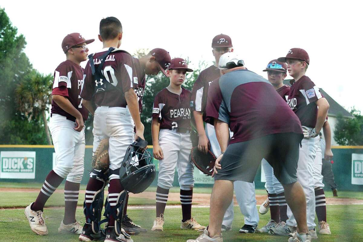 Pearland East All Stars' coach Jeff Sills speaks to his team during the section 3 championship game against Post Oak Little League Saturday in Pearland.