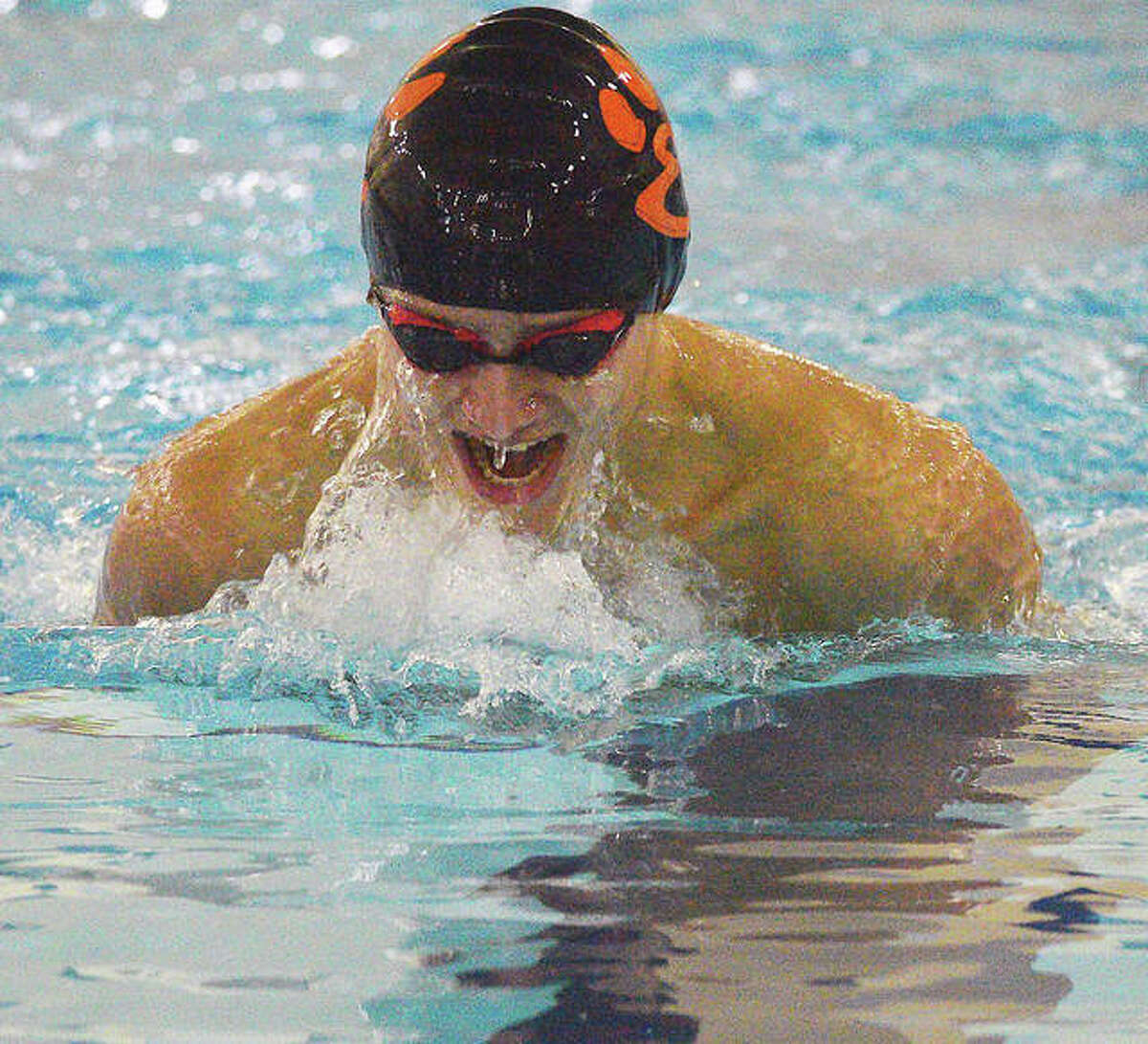 Edwardsville's Evan Grinter swims the breaststroke during a 2021 meet. Grinter is the 2021 Telegraph Boys Swimmer of the Year.