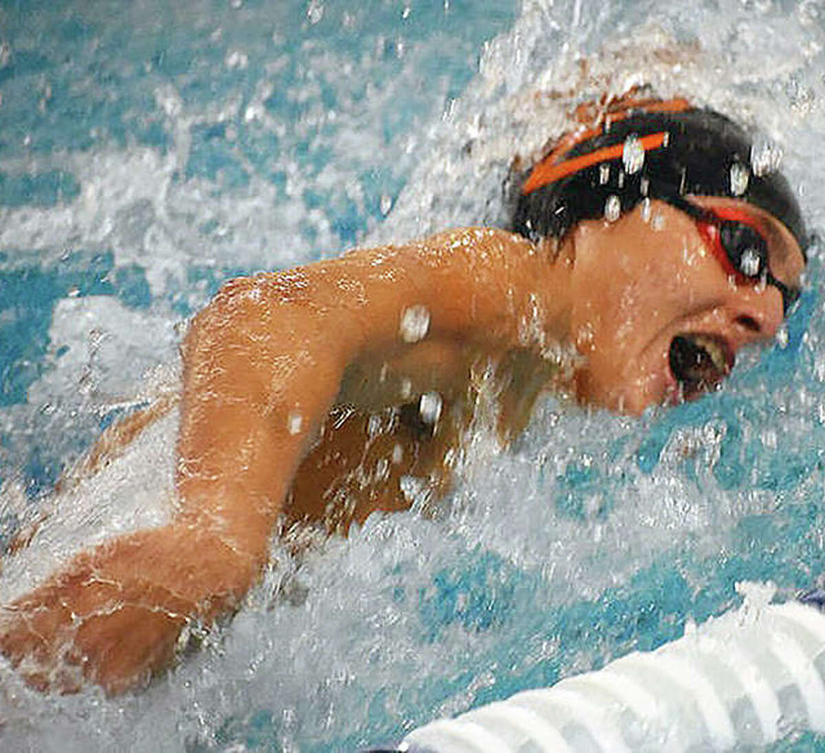 Evan Grinter of Edwardsville won the 50-yard freestyle in 21.87 seconds and won the 100-yard freestyle in 49.57 at the Region 4 meet, which was put together to take the place of the traditional IHSA area sectional meet. The IHSA cancelled the boys swim postseason last season because of the pandemic.