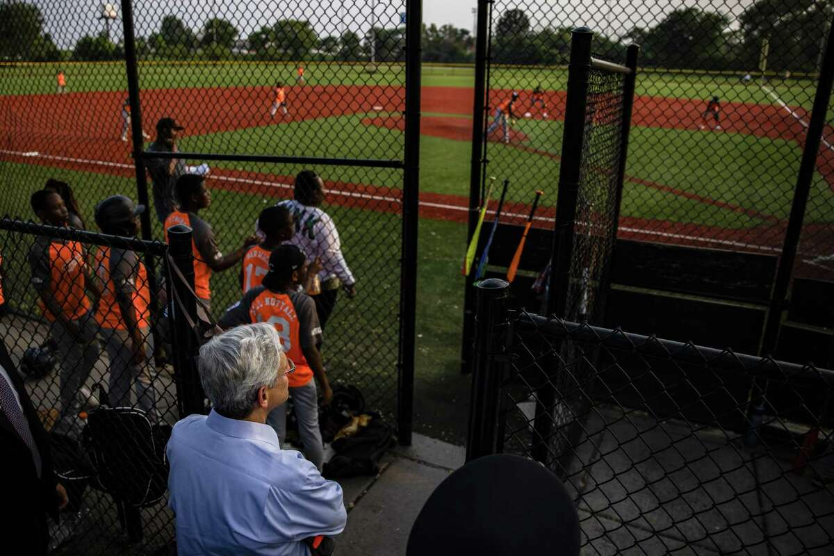 Merrick Garland, U.S. attorney general, watches a youth baseball game held by the Chicago Westside Sports, a part of The Chicago Police Departments formed Police Athletic League, at Columbus Park in Chicago, Illinois, U.S., on Thursday, July 22, 2021. Garland and the deputy U.S. attorney general today announced an initiative to reduce gun violence with a five cross-jurisdictional strike forces by disrupting illegal firearms trafficking in key regions across the United States. Photographer: Samuel Corum/Bloomberg
