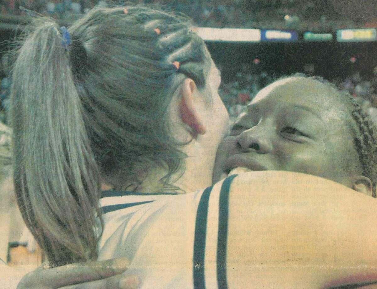 Plainview seniors Tojjinay Thompson (right) and Alesha Robertson embrace after winning the 2003 state championship.