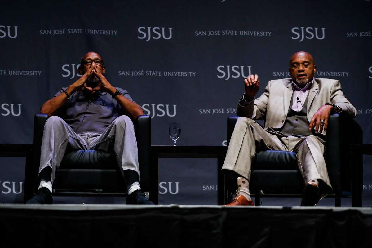 John Carlos, left, and Tommie Smith are among the more than 150 athletes, educators and activists who signed a letter Thursday urging the IOC not to punish participants who demonstrate at the Tokyo Games.