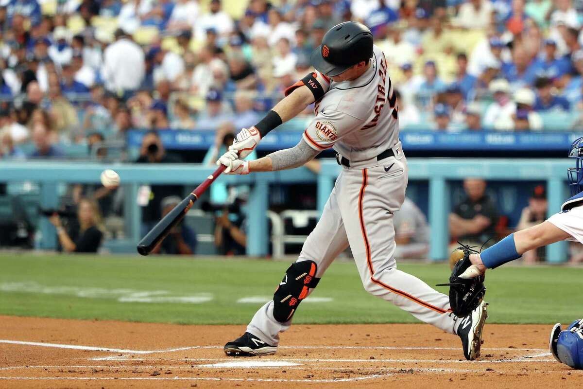 LOS ANGELES, CALIFORNIA - JULY 22: Mike Yastrzemski #5 of the San Francisco Giants hits a sacrifice fly for an RBI in the first inning against the Los Angeles Dodgers at Dodger Stadium on July 22, 2021 in Los Angeles, California. (Photo by Katelyn Mulcahy/Getty Images)