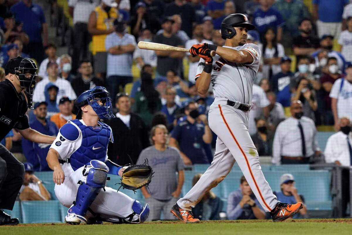 LaMonte Wade Jr. drives in the go-ahead runs with a single in the ninth inning as San Francisco pulled off a comeback against their rivals.
