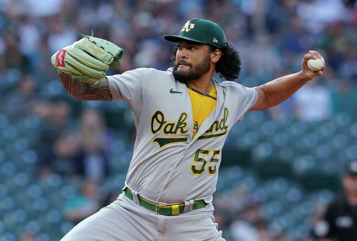 Oakland Athletics starting pitcher Sean Manaea throws to a Seattle Mariners batter during the first inning of a baseball game Thursday, July 22, 2021, in Seattle. (AP Photo/Ted S. Warren)