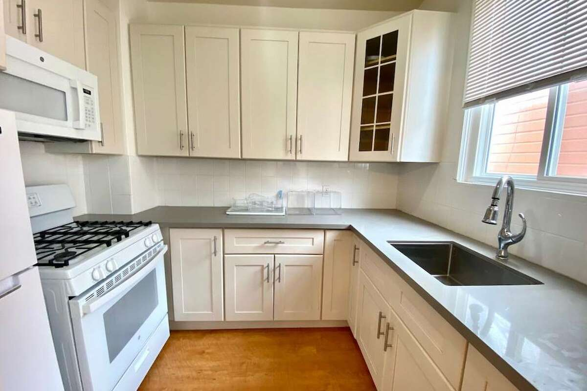 The kitchen is updated with new counters and cabinets, though it doesn't look like there's a dishwasher.
