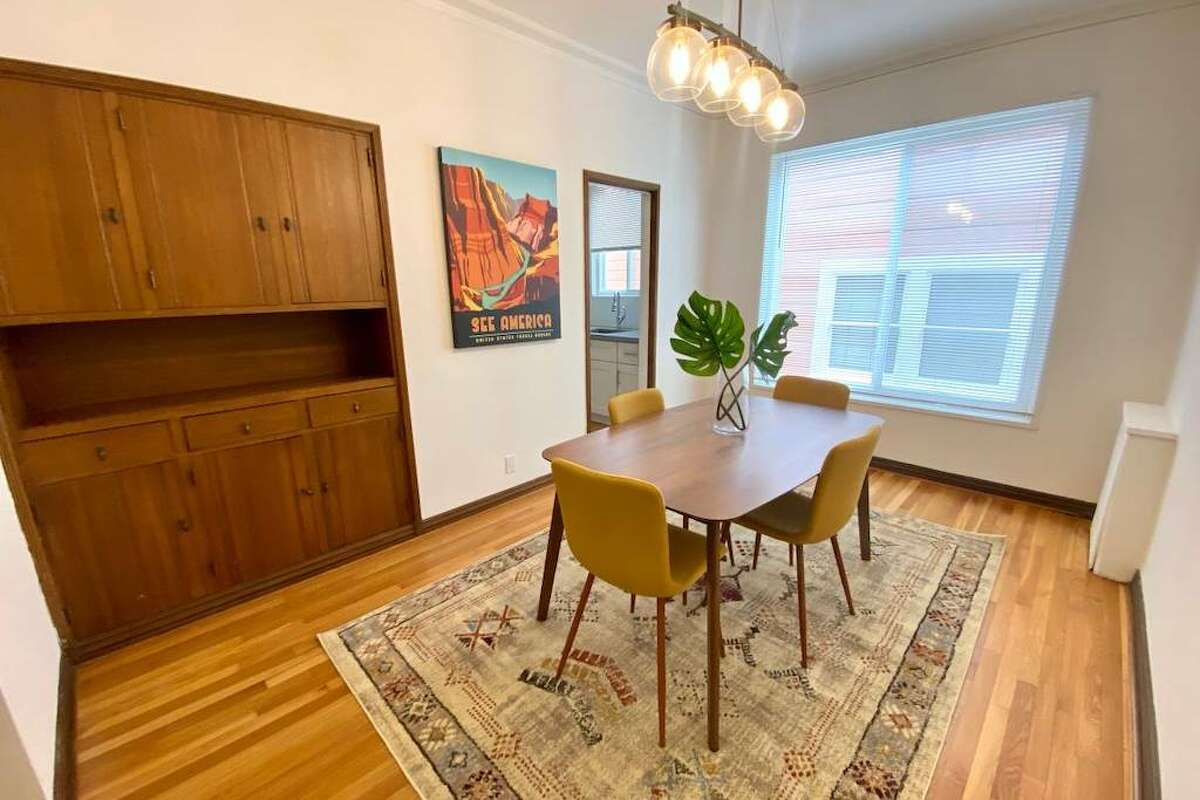 There's a formal living room and dining room, one of which could be used as a second bedroom if roommates desired. There's built in cabinetry in the dining room. Doors close between the rooms.