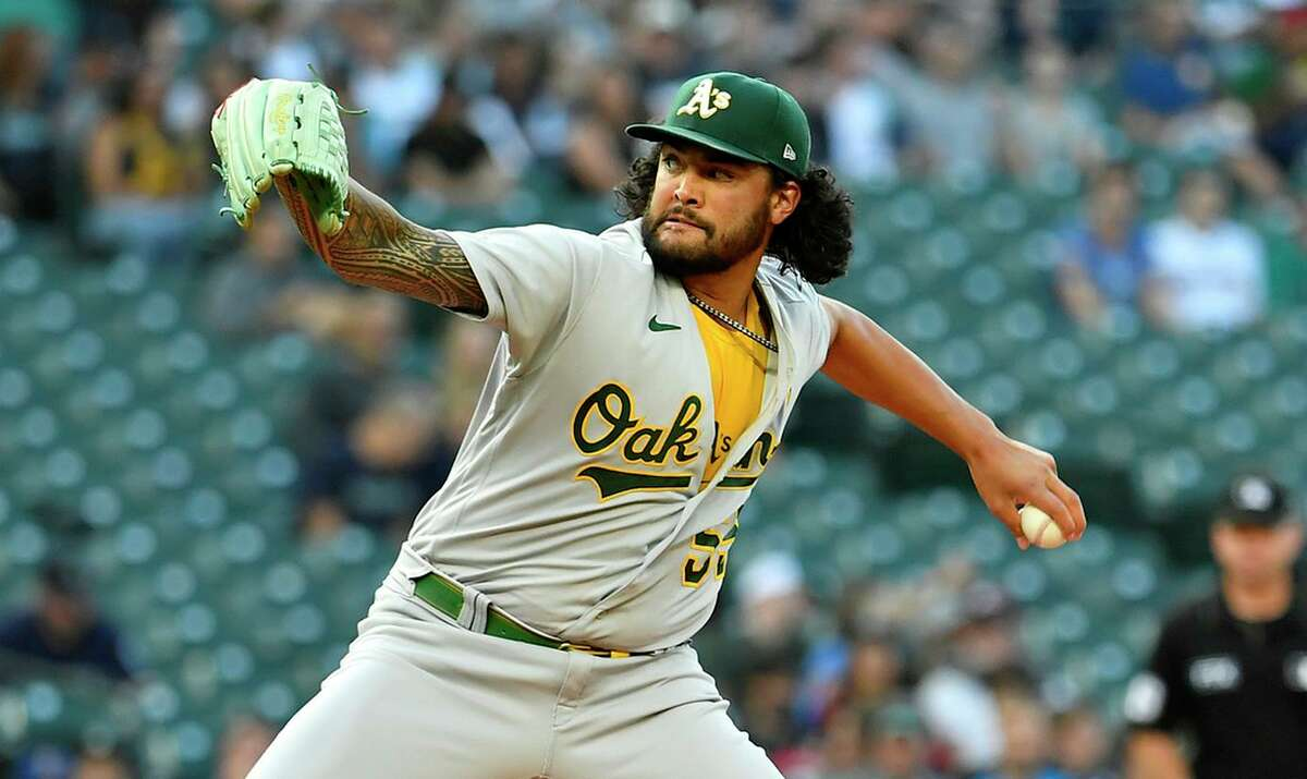SEATTLE, WASHINGTON - JULY 22: Sean Manaea #55 of the Oakland Athletics throws a pitch during the first inning of the game against the Seattle Mariners at T-Mobile Park on July 22, 2021 in Seattle, Washington. (Photo by Alika Jenner/Getty Images)